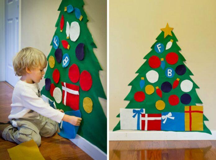 Materiali colorati e riciclati, fantasia infinita del bambino e l'albero di Natale montessoriano è servito